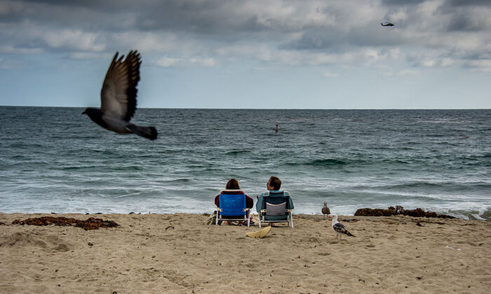 A couple rests on the beach during a late afternoon at Laguna Beach, Calif., on June 3, 2012. (Joe Klamar/AFP via Getty Images)