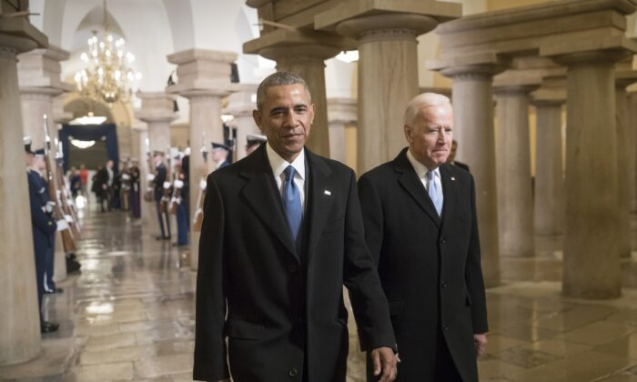 President Barack Obama and Vice President Joe Biden walk through the Crypt of the Capitol for Donald Trump's inauguration ceremony, in Washington on Jan. 20, 2017. (J. Scott Applewhite/Getty Images)