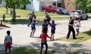 'Karen' Reports Kids for Playing Football in the Street–Then Cops Respond by Joining the Game