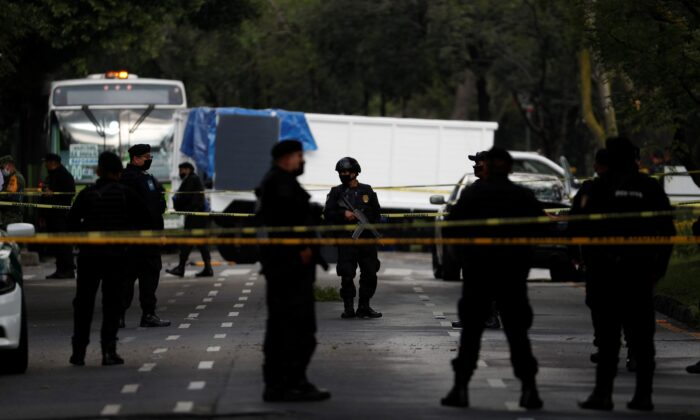 Police stand guard at a crime scene where the chief of police was attacked by gunmen in the early morning hours, in Mexico City, on June 26, 2020. (Rebecca Blackwell/AP Photo)