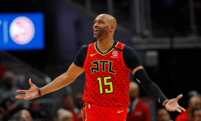 Vince Carter #15 of the Atlanta Hawks reacts after being charged with a foul in the second half against the Houston Rockets at State Farm Arena in Atlanta, Ga., on Jan. 08, 2020. (Kevin C. Cox/Getty Images)