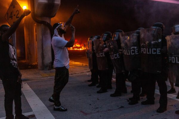 Protesters confronts riot police