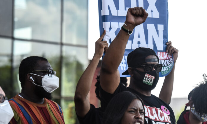Hawk Newsome (R) holds his fist up at a rally in Brooklyn, New York City, on May 15, 2020. (Stephanie Keith/Getty Images)
