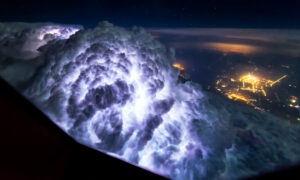 Pilot Photographs Storm Clouds, Lightning, Northern Lights In-flight–and the Results Are Epic