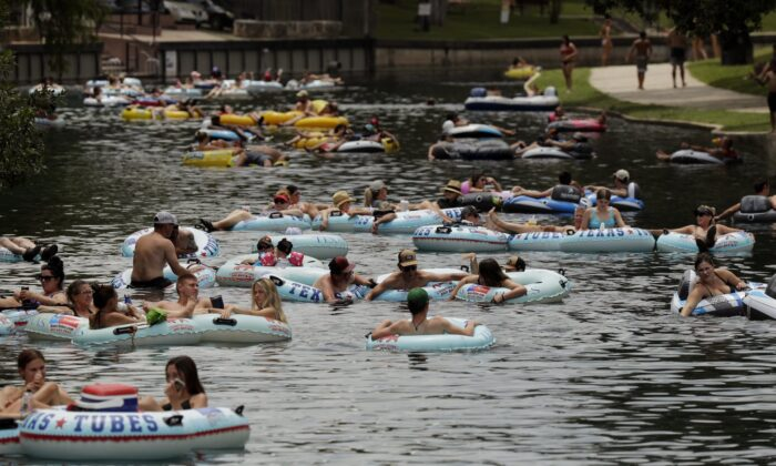 Tubers float the Comal River despite the recent spike in COVID-19 cases  in New Braunfels, Texas, on June 25, 2020. (Eric Gay/AP Photo)
