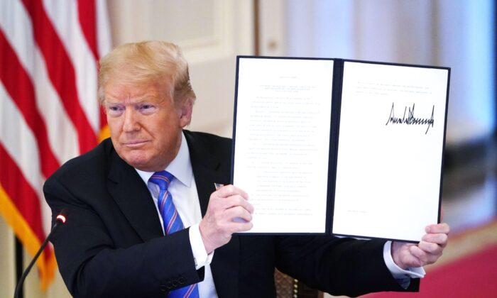 """President Donald Trump holds an executive order on """"Continuing the President's National Council for the American Worker and the American Workforce Policy Advisory Board"""" in the East Room of the White House in Washington, on June 26, 2020. (Mandel Ngan/AFP via Getty Images)"""