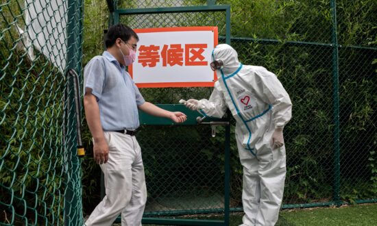 Virus Outbreak in Beijing Shuts Down Neighborhoods, Businesses