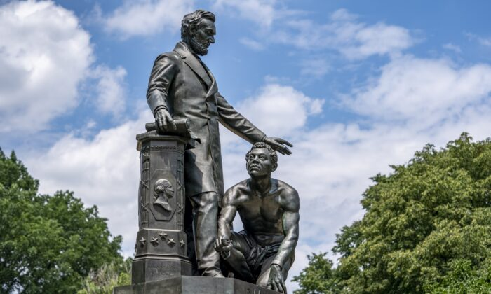 The Emancipation Memorial in Washington's Lincoln Park depicts a freed slave kneeling at the feet of President Abraham Lincoln, June 25, 2020. (J. Scott Applewhite/AP Photo)