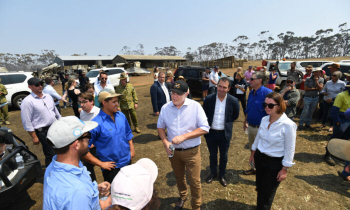 Australian Prime Minister Scott Morrison is seen with South Australian Premier Steven Marshall and Senator Anne Ruston during a visit to a fire damaged property on Stokes Bay on Kangaroo Island, southwest of Adelaide, Wednesday, January 8, 2020.(David Mariuz-Pool via Getty Images)