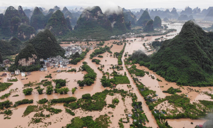 The submerged streets and buildings after heavy rain caused flooding in Yangshuo, in China's southern Guangxi region on June 7, 2020. (STR/AFP via Getty Images)