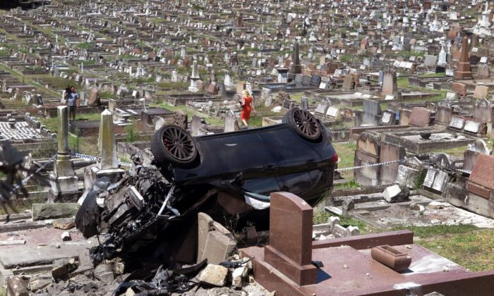 A Mercedes SUV lies amongst the gravestones at a cemetery in the Sydney suburb of South Coogee on February 6, 2018. (WILLIAM WEST/Getty Images)