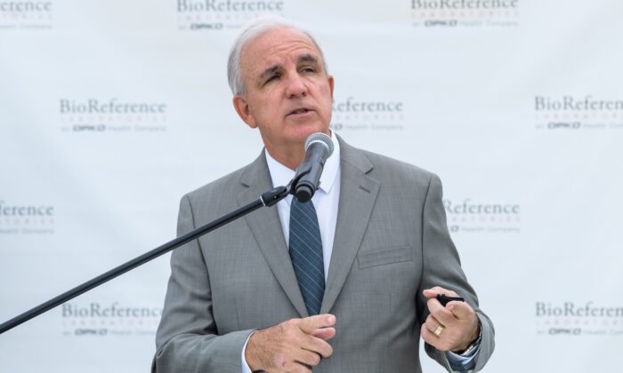 Miami-Dade County Mayor Carlos A. Gimenez speaks during BioReference Laboratories hosts Grand Opening of COVID-19 Antibody Testing Collection Event at the Miami International Mall with local Government Officials providing opening remarks in Doral, Fla., on June 18, 2020. (Jason Koerner/Getty Images for BioReference Laboratories)