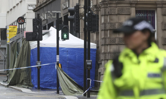 A police Incident tent at the scene where a man was shot by armed officers after another police officer was injured during an attack on Friday, in Glasgow, Scotland, as investigations continue Sunday June 28, 2020. (Andrew Milligan/PA via AP)