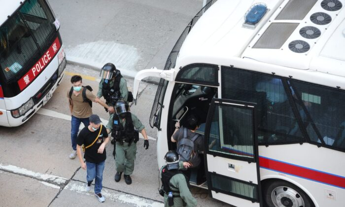 Protesters are arrested by local police in Mong Kok, Hong Kong, on June 28, 2020. (Song Bilung/The Epoch Times)
