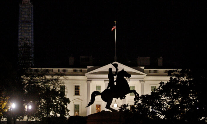 The statue of U.S. President Andrew Jackson on his horse in the center of Lafayette Park is silhouetted against the White House in front of the Washington Monument in Washington on Nov. 17, 2013. (Jim Bourg/Reuters)