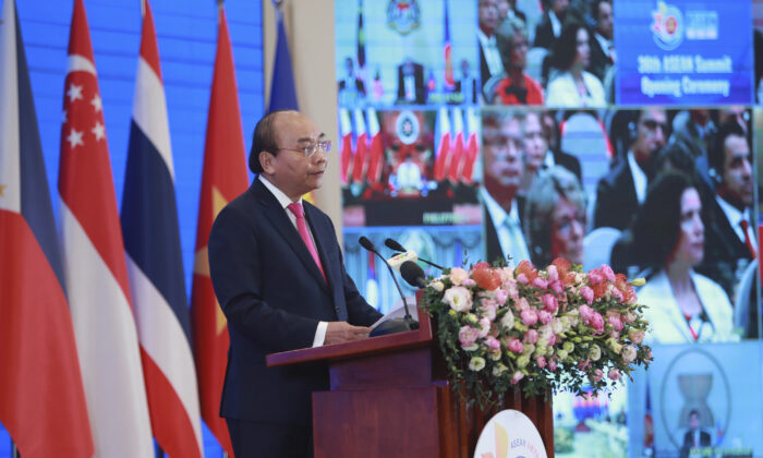 Vietnamese Prime Minister Nguyen Xuan Phuc delivers a speech at the opening ceremony of the 36th ASEAN Summit in Hanoi, Vietnam, on June 26, 2020. (Hau Dinh/AP Photo)