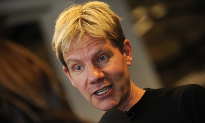 Danish professor Bjorn Lomborg speaks with a journalist at the Bella center of Copenhagen on Dec. 15, 2009, the 9th day of the COP15 U.N. Climate Change Conference. (Adrian Dennis/AFP via Getty Images)
