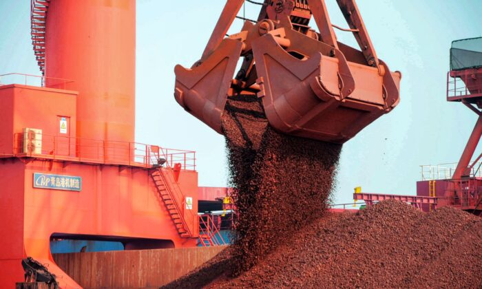 This photo taken on October 20, 2019 shows imported iron ore being unloaded at a port in Qingdao in eastern China's Shandong province. (STR/AFP via Getty Images)