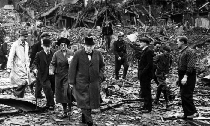 Prime Minister Winston Churchill inspects air raid damage in Battersea, south London, on Sept. 10, 1940. (Reg Speller/Fox Photos/Getty Images)