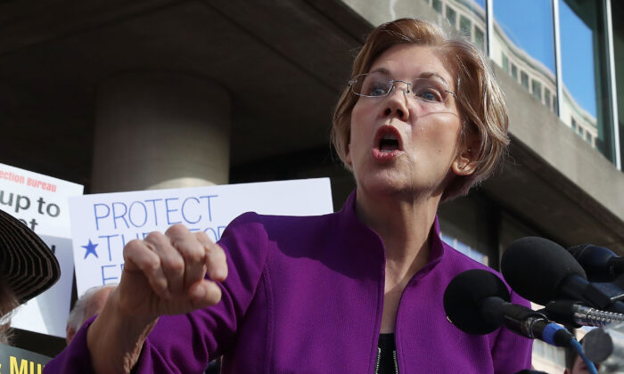 Sen. Elizabeth Warren (D-Mass.) speaks during a protest in front of the 