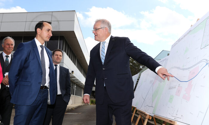 Member for Wentworth Dave Sharma and Prime Minister Scott Morrison discuss the planning maps at an infrastructure announcement in Macquarie Park in Sydney, Australia on June 29, 2020. (Mark Kolbe/Getty Images)