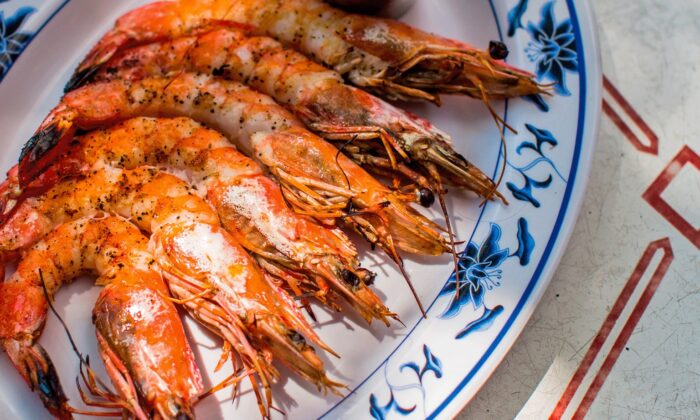 Grilled jumbo Gulf shrimp with nam jim, a sweet-sour-spicy Thai dipping sauce, reflects Caitlin Carney and Marcus Jacob's Mekong Delta-meets-Louisiana culinary sensibilities. (Andrea Behrends and Helene Dujardin)
