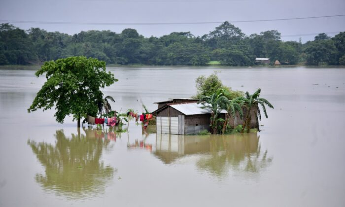 A partially submerged house is seen at the flood-affected Mayong village in Morigaon district, in the northeastern state of Assam, India,on June 29, 2020. (Anuwar Hazarika/Reuters)