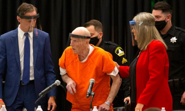 Joseph James DeAngelo (C) charged with being the Golden State Killer, is helped up by his attorney, Diane Howard, as Sacramento Superior Court Judge Michael Bowman enters the courtroom in Sacramento, Calif., on June 29, 2020. (Rich Pedroncelli/AP Photo)