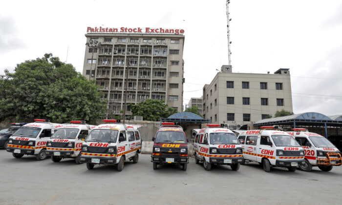 Ambulances are seen parked outside Pakistan Stock Exchange building after an attack in Karachi on June 29, 2020. (Akhtar Soomro/Reuters)