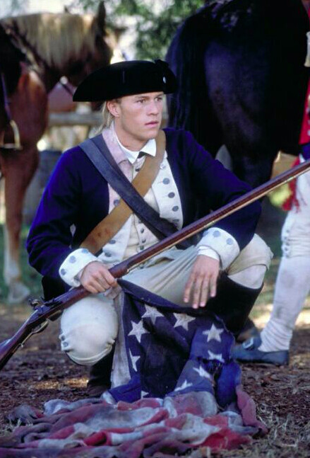 """young man in blue coat with rifle in """"The Patriot"""""""