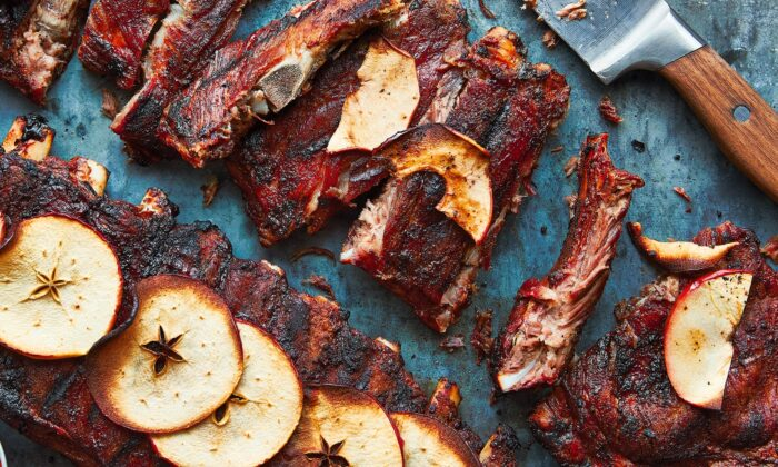 Sylvester Hoover's grilled spareribs are seasoned with garlic powder and Lawry's, finished with sweet apple slices, and served to a tight-knit community. (Andrea Behrends and Helene Dujardin)