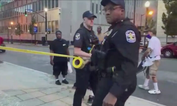 Police cordon off the area after a fatal shooting at Jefferson Square Park, in Louisville, Ky., June 27, 2020, in a still image obtained from a social media video. (Maxwell Mitchell via Reuters)