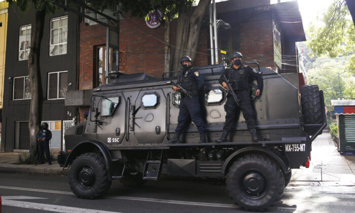 A police vehicle arrives to the place where an abandoned vehicle that is believed to have been used by gunmen in an attack against the chief of police was found, in Mexico City on June 26, 2020. (Marco Ugarte/AP)