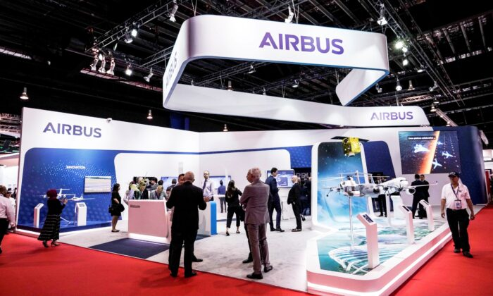 Visitors at the booth of Airbus during the opening trade day of the Singapore Airshow 2020 in Singapore, on Feb. 11, 2020. (Danial Hakim/AP Photo)