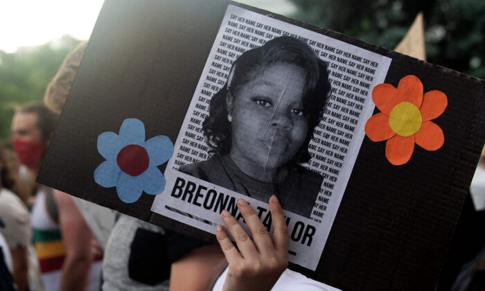 A demonstrator holds a sign with the image of Breonna Taylor in Denver, Colo., on June 3, 2020. (Jason Connolly/AFP via Getty Images)