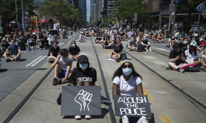 Thousands of people protest to defund the police in support of Black Lives Matter in Toronto, Canada, on June 19, 2020. (Nathan Denette/The Canadian Press)