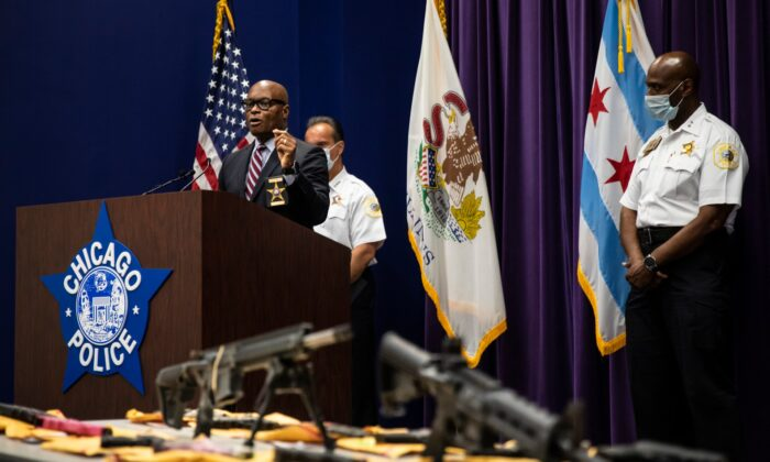 Chicago Police Supt. David Brown gestures toward a table of guns allegedly confiscated by Chicago police officers over the weekend during a news conference at CPD headquarters, on June 29, 2020. (Ashlee Rezin Garcia/Chicago Sun-Times/AP)