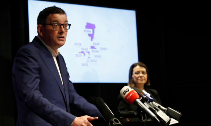 Victorian premier Daniel Andrews speaks to the media on June 30, 2020 in Melbourne, Australia. A graphic displaying 10 Melbourne post codes that will required to go to further restrictions at midnight on July 1st. (Darrian Traynor/Getty Images)