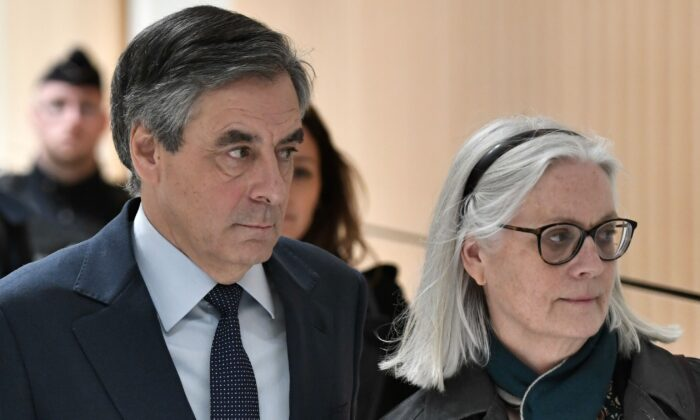 Former French Prime minister Francois Fillon (L) and his wife Penelope arrive at the Paris' courthouse, on Feb. 27, 2020. (Stephane de Sakutin/AFP via Getty Images)