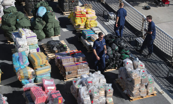 The crew of the Coast Guard Cutter James is seen on deck as wrapped packages of approximately 27,300 pounds of cocaine and 11,000 pounds marijuana is prepared to be offloaded at Port Everglades in Fort Lauderdale, Fla., on Oct. 28, 2019. (Joe Raedle/Getty Images)