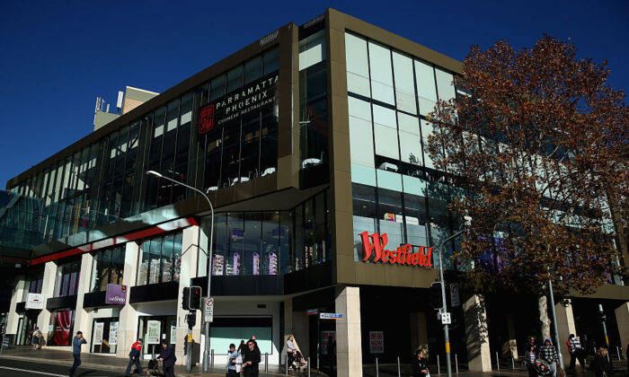 People walk past Westfield shopping centre in central Parramatta on June 3, 2015 in Sydney, Australia. (Cameron Spencer/Getty Images)