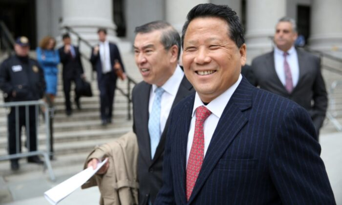 Macau billionaire real estate developer Ng Lap Seng (R), accused of bribing former United Nations General Assembly President John Ashe, exits the Manhattan U.S. District Courthouse in New York, on April 7, 2017. (Ashlee Espinal/Reuters)