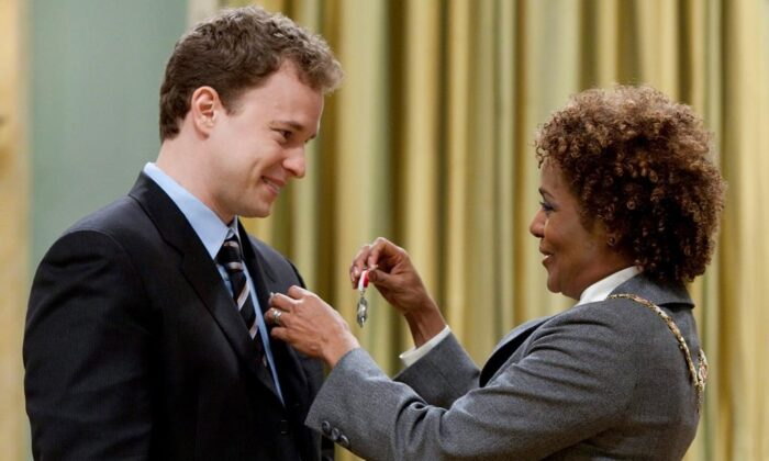 """Marc Kielburger from Toronto receives the Order of Canada from Governor General Michaelle Jean during a ceremony at Rideau Hall in Ottawa on Wednesday April 7, 2010. One of the co-founders of WE Charity says he """"misspoke"""" when he told youth leaders earlier this month that Prime Minister Justin Trudeau's staff reached out in April to see if the organization would administer a $900-million federal student-aid program. (Sean Kilpatrick/The Canadian Press)"""