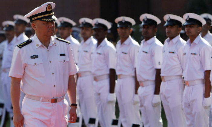 Chinese People's Liberation Army (PLA) Navy Commander Wu Shengli (L) inspects a guard of honor in New Delhi, India, on Nov. 3, 2008. (Manan Vatsyayana/AFP via Getty Images)