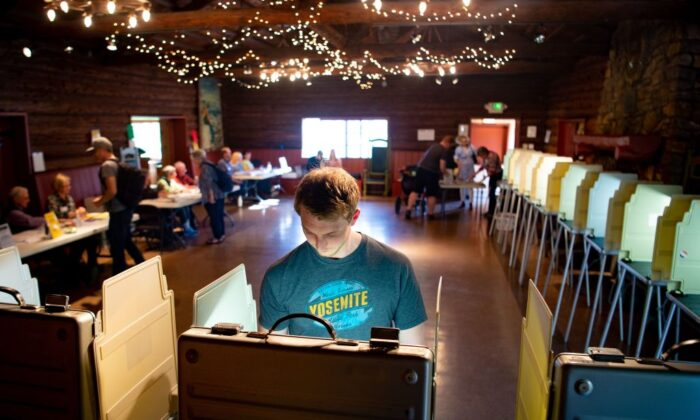 Voters fill out their ballots for the presidential primary in a log cabin run by the American Legion in San Anselmo, Calif., on March 3, 2020. (Josh Edelson/AFP via Getty Images)