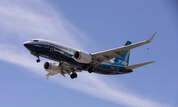 A Boeing 737 MAX airplane lands after a test flight at Boeing Field in Seattle, Washington on June 29, 2020. (Karen Ducey?Reuters)