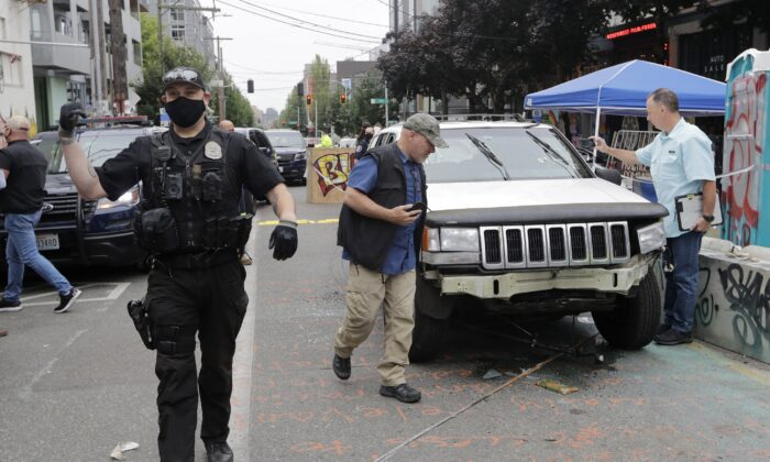 A car sits in the Capitol Hill Organized Protest zone following a shooting in Seattle, Wash., on June 29, 2020. (Aron Ranen/AP Photo)