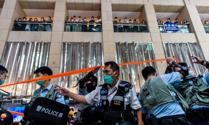 Police enter a shopping mall to disperse people attending a lunchtime rally in Hong Kong on June 30, 2020, as China passed a sweeping national security law for the city. (Anthony Wallace/AFP via Getty Images)