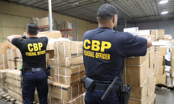 U.S. Customs and Border Protection (CBP) officers inspect shipment of hair products from China at the port of New York/Newark on July 1, 2020. (CBP)