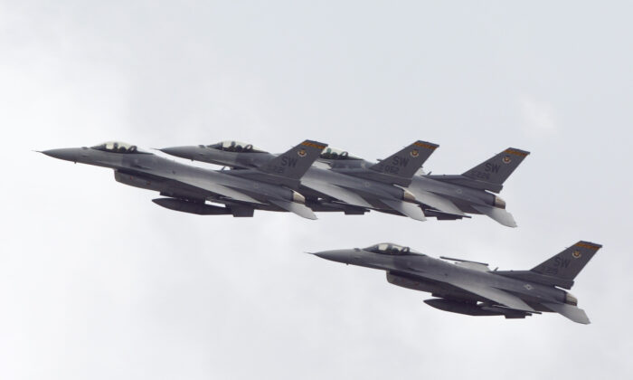 Four F-16's from the 79th Fighter Squadron at Shaw Air Force Base fly over during pre race ceremonies at the NASCAR Winston Cup Series Daytona 500 at the Daytona International Speedway in Daytona Beach, Fla., on Feb. 16, 2003. (Robert Laberge/Getty Images)